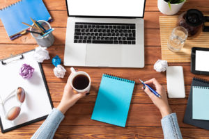Business Woman Writing In Notebook At Office Desk. Online Busine